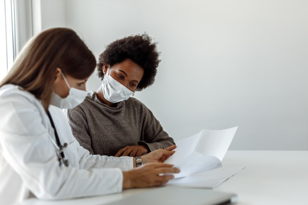 Doctor speaking to her patient about Genetic testing for Atrial Fibrillation
